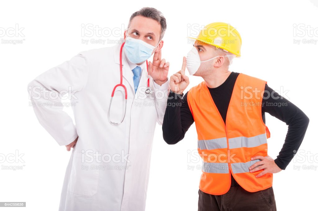 Doctor making listening gesture and constructor showing sush stock photo