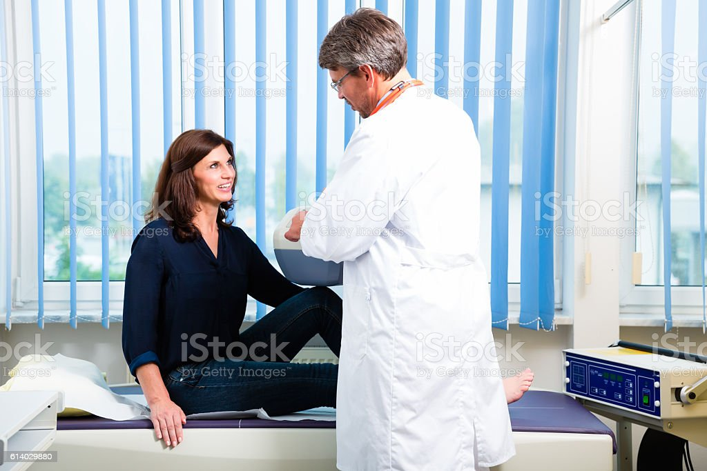 Doctor making x-ray of patient leg in surgery stock photo