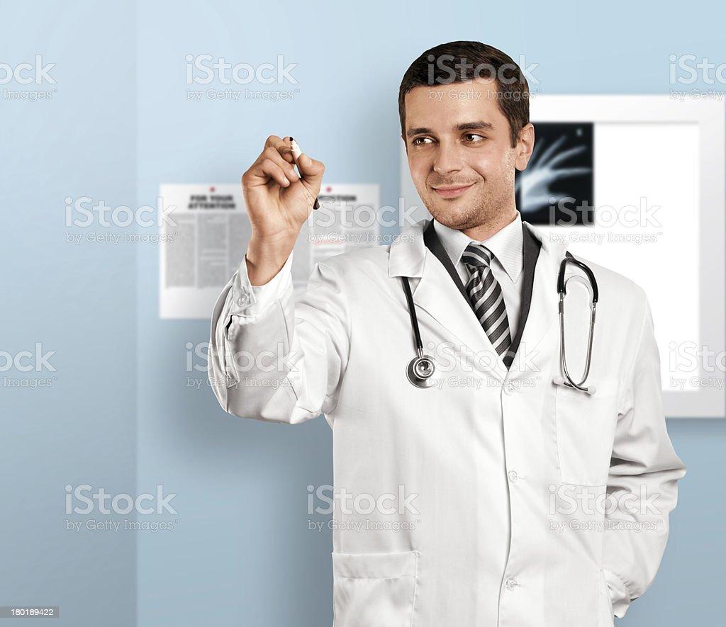 Doctor Man Writing Something royalty-free stock photo