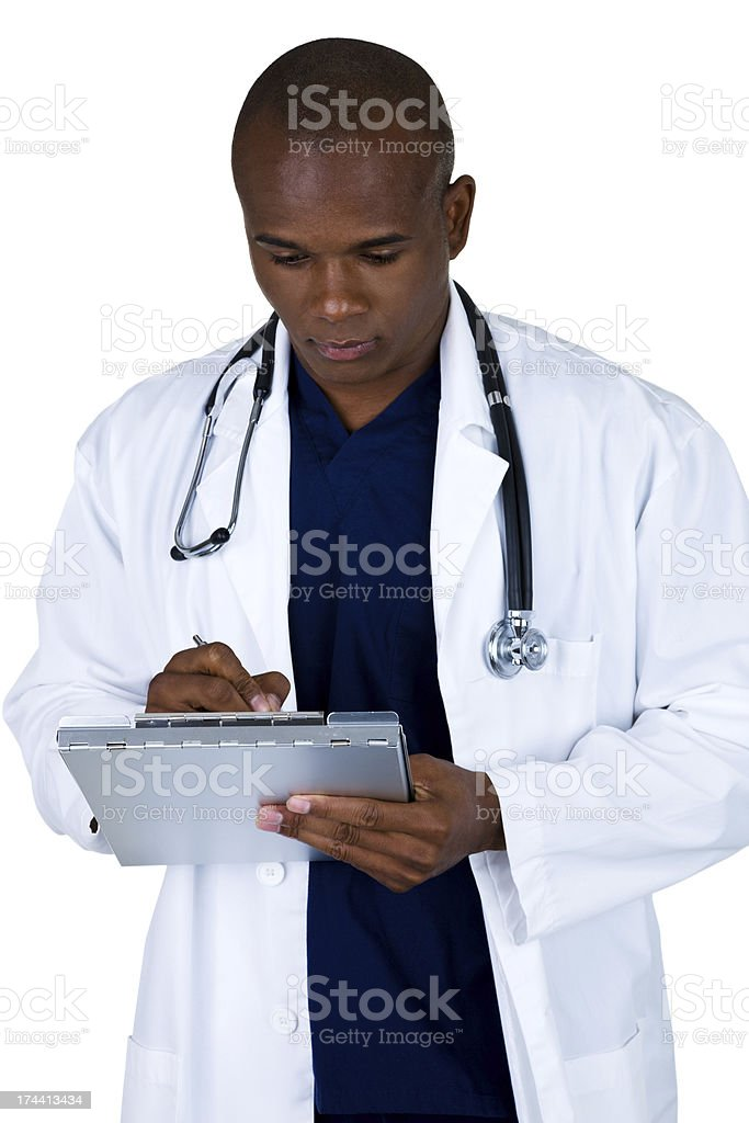 Doctor marking a medical chart royalty-free stock photo