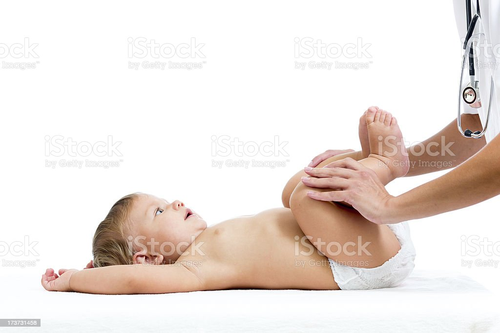 doctor massaging or doing gymnastics baby girl royalty-free stock photo