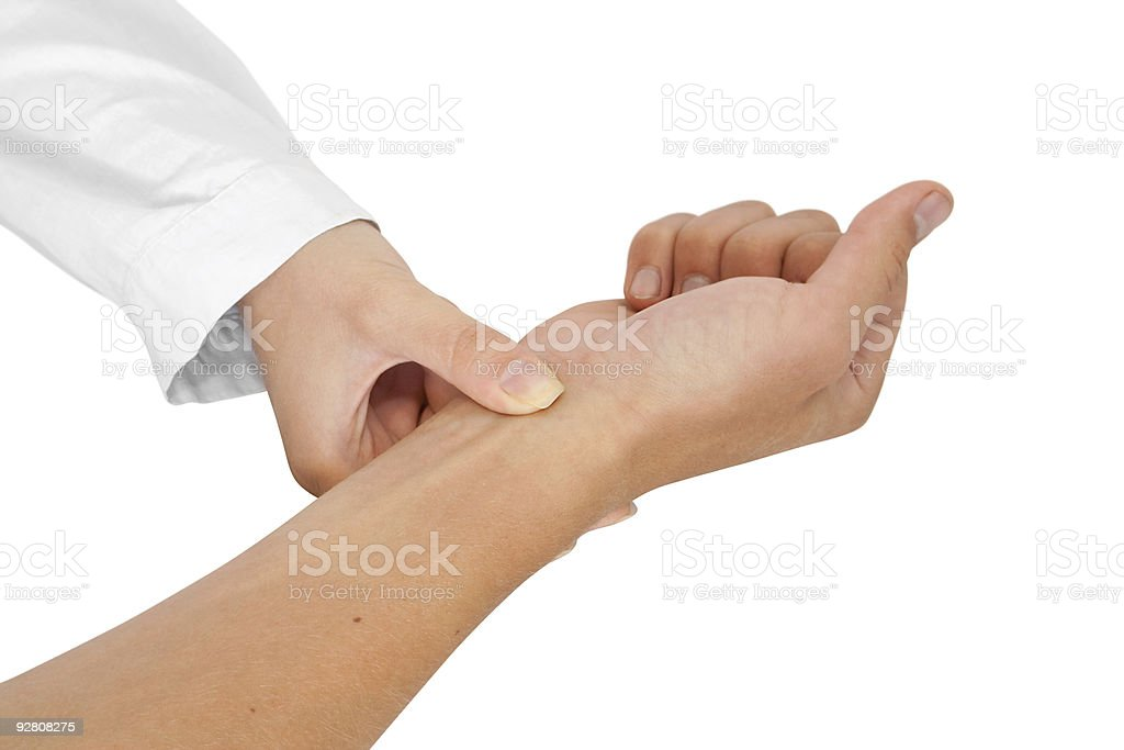 doctor measures pulse royalty-free stock photo