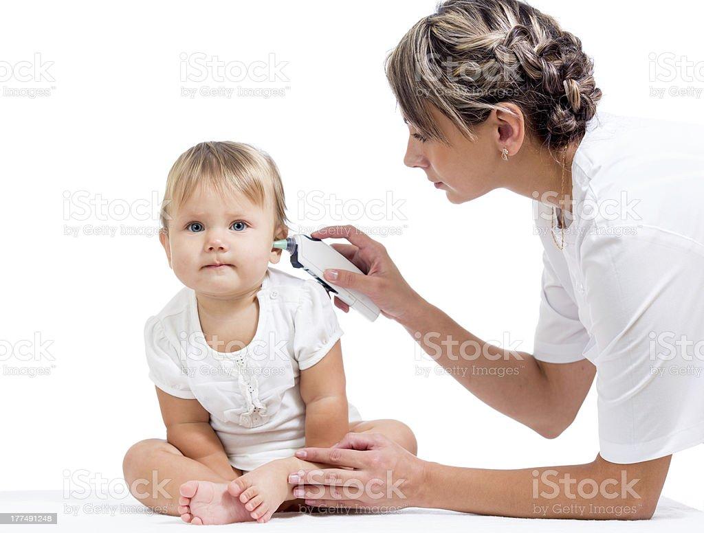 doctor measuring  temperature cute baby girl stock photo
