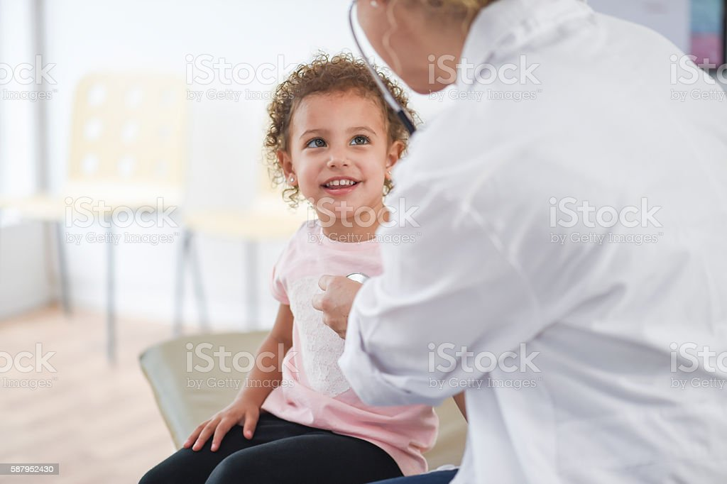 Doctor Meeting with a Little Girl stock photo