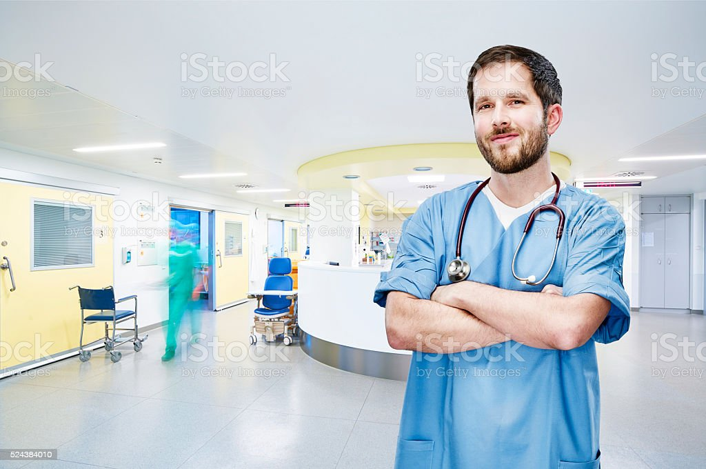 OP doctor portrait with stethoscope draped head in the hallway at the...