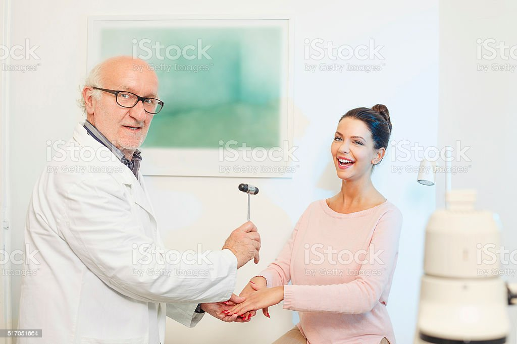 Doctor neurologist testing  reflex  use Medical tendon hammer stock photo