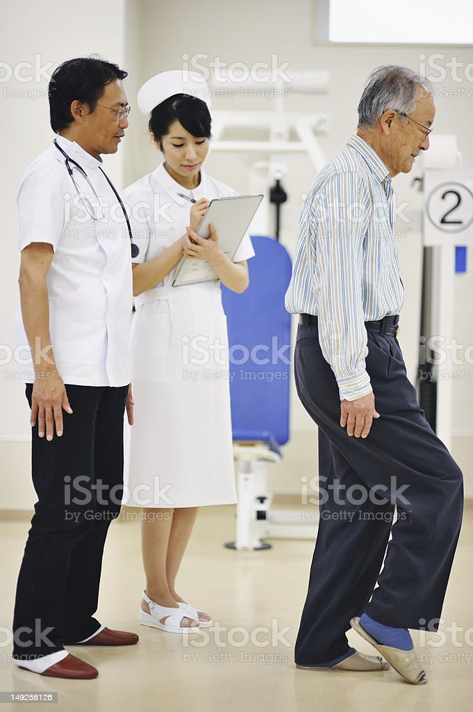 Doctor Observing Senior Pateint in Hospital royalty-free stock photo