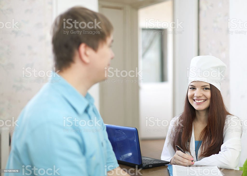 Doctor of prescribes to patient the medication stock photo