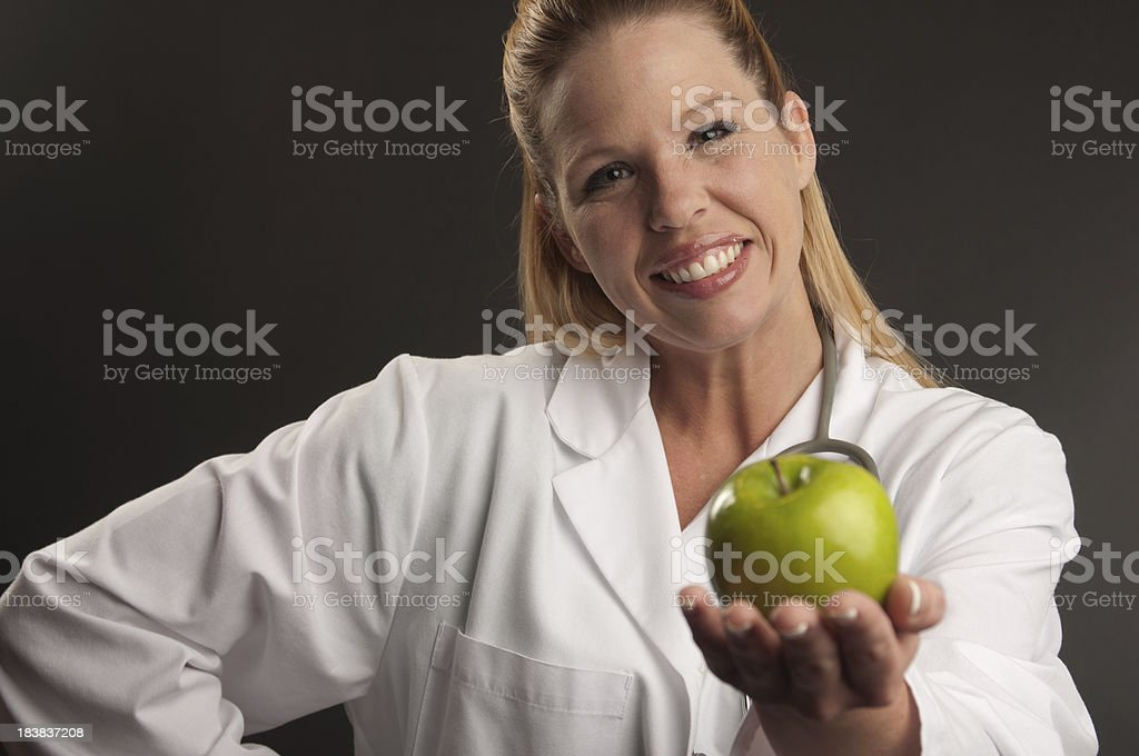 Doctor Offering Apple royalty-free stock photo