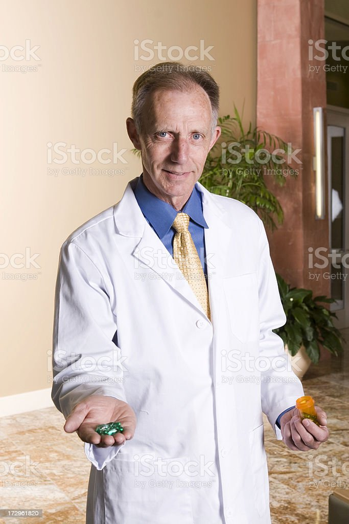 Doctor offering medication royalty-free stock photo