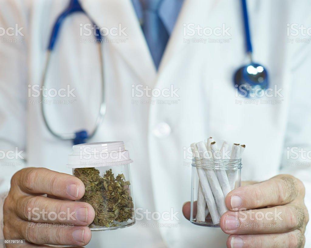 Doctor offering patient medical marijuana stock photo