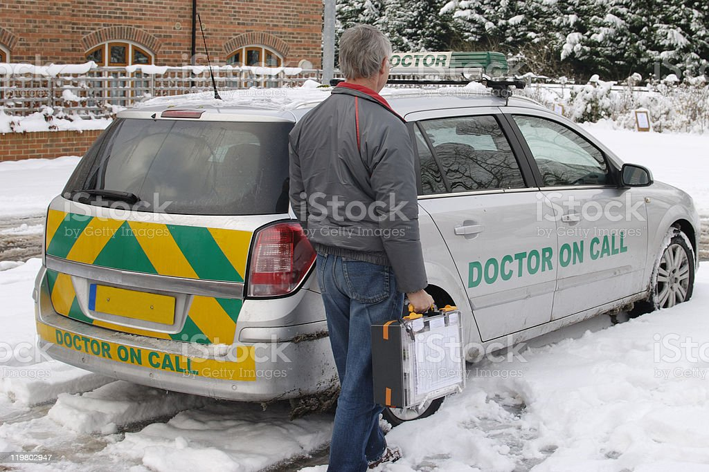 Doctor on call by vehicle in snow royalty-free stock photo