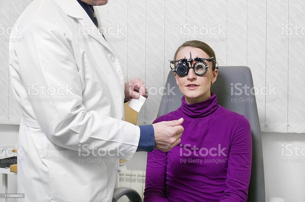 Doctor ophthalmologist with patient royalty-free stock photo