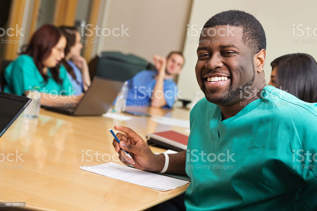 Doctor or nurse in staff meeting at hospital board room royalty-free stock photo