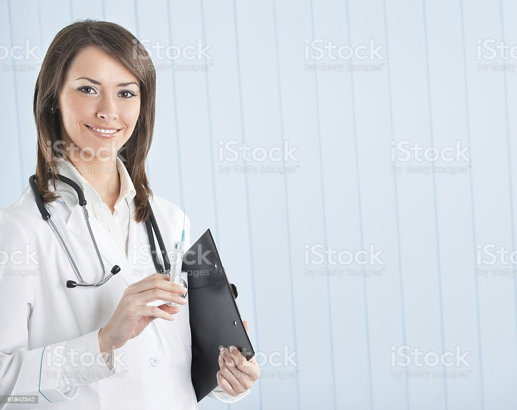 Doctor or nurse with syringe and clipboard at office royalty-free stock photo