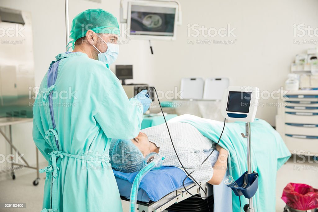 Doctor performing an endotracheal intubation stock photo