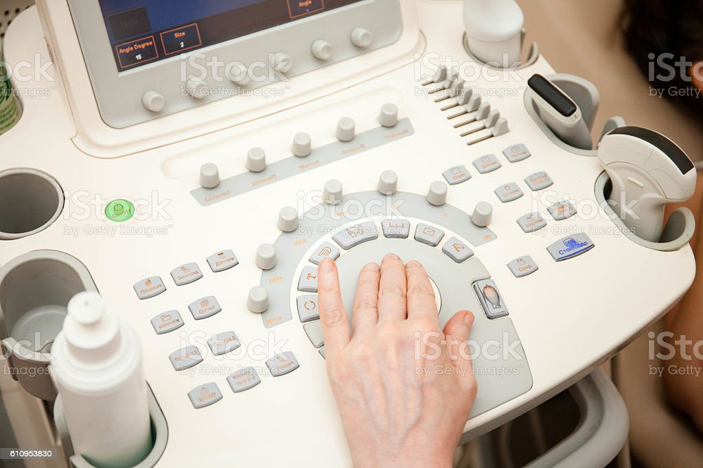 Doctor performing an ultrasound examination stock photo