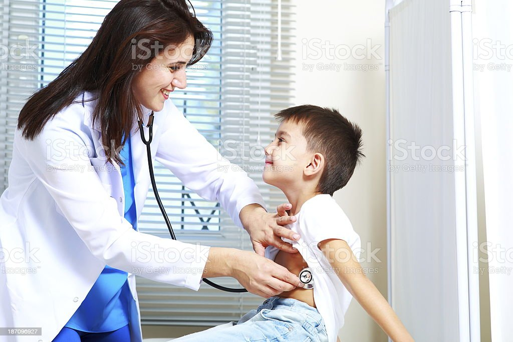 Doctor performing check up on young child royalty-free stock photo