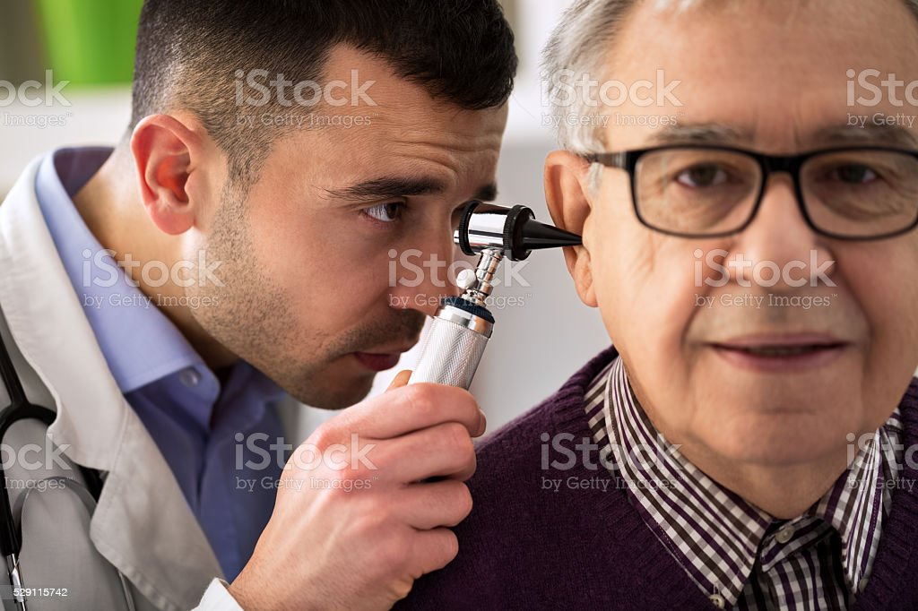 Doctor Performs an Ear Examination stock photo