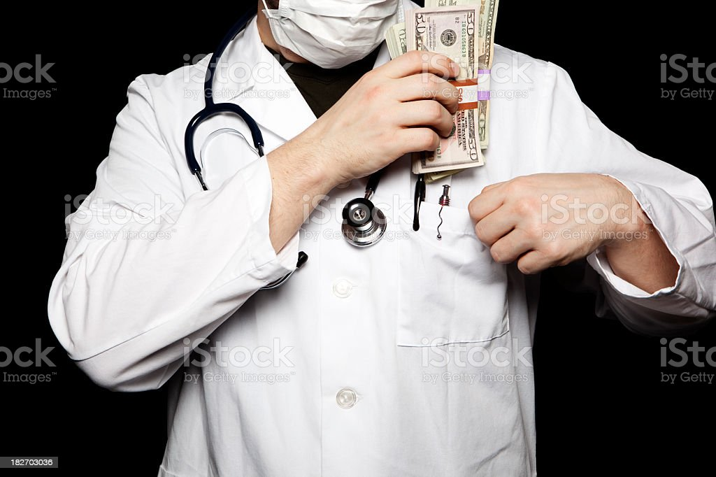 Doctor pocketing Cash royalty-free stock photo