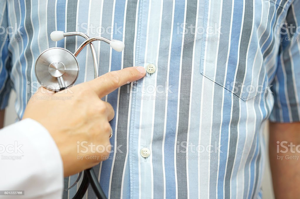 doctor pointing to stomach, .gastrointestinal disorders stock photo