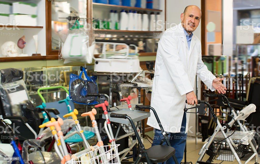 Doctor posing near orthopaedic equipment stock photo