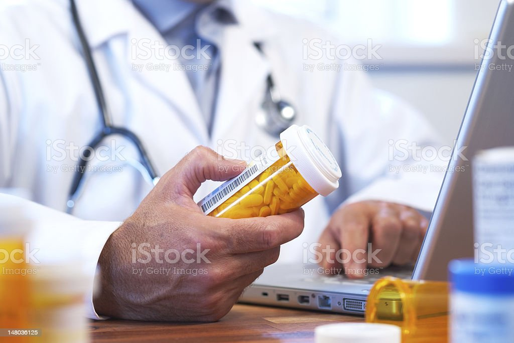 Doctor preparing online internet prescription stock photo