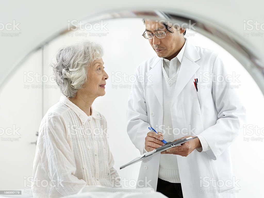 Doctor preparing patient for MRI exam royalty-free stock photo