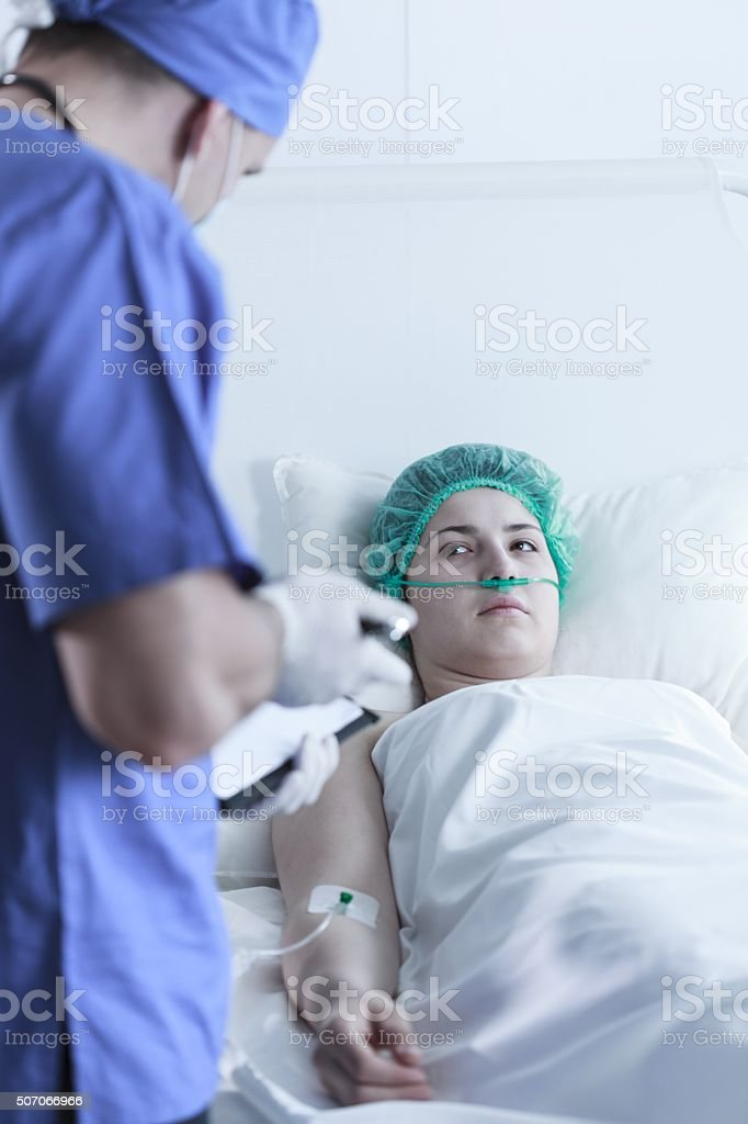 Doctor preparing patient for surgery stock photo