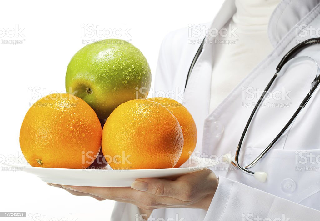 Doctor prescribing healthy eating royalty-free stock photo