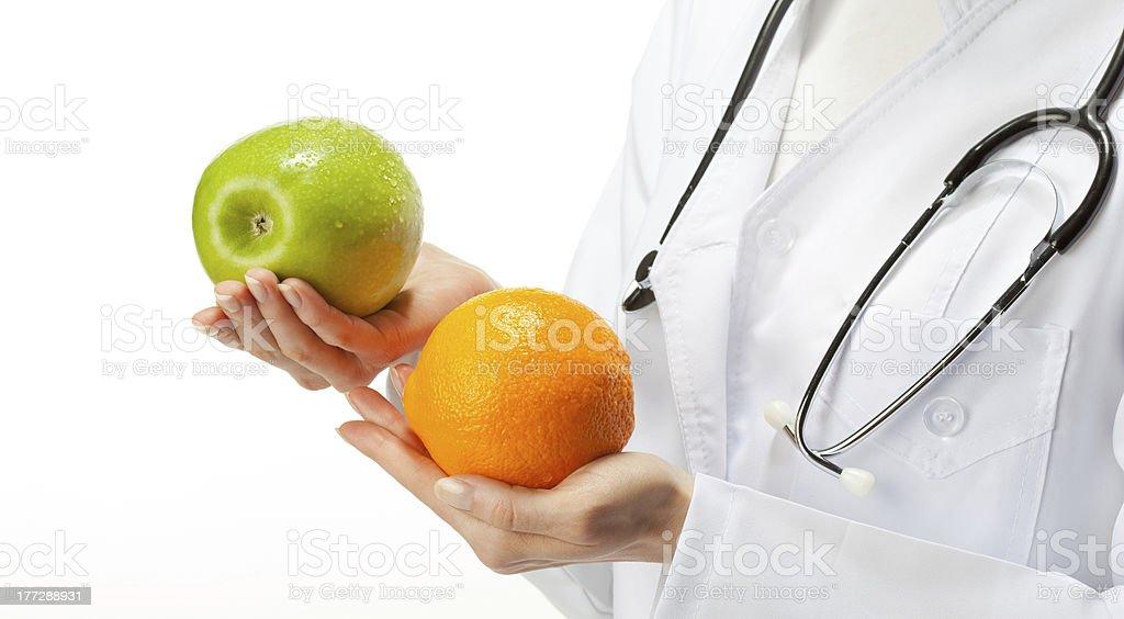 Doctor prescribing healthy eating royalty-free stock photo