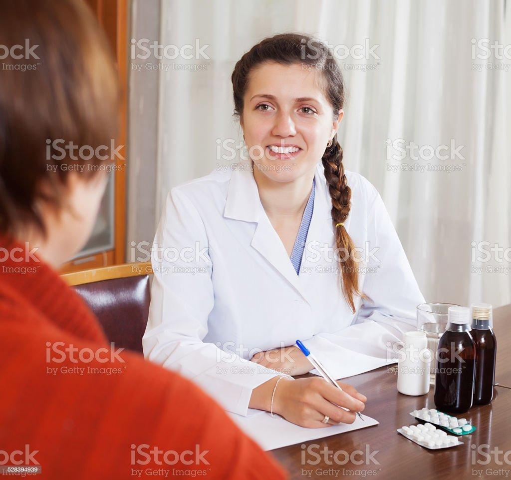 doctor prescribing medication stock photo