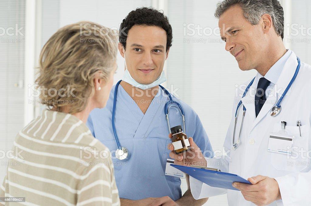 Doctor Prescribing Medication To Patient stock photo