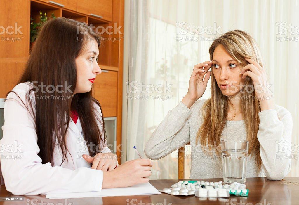 doctor prescribing medication to  woman stock photo