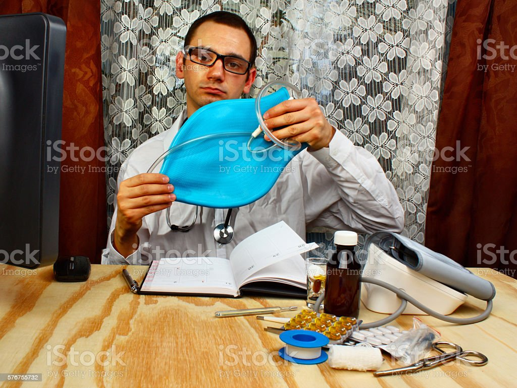 Doctor proctologist and enema stock photo