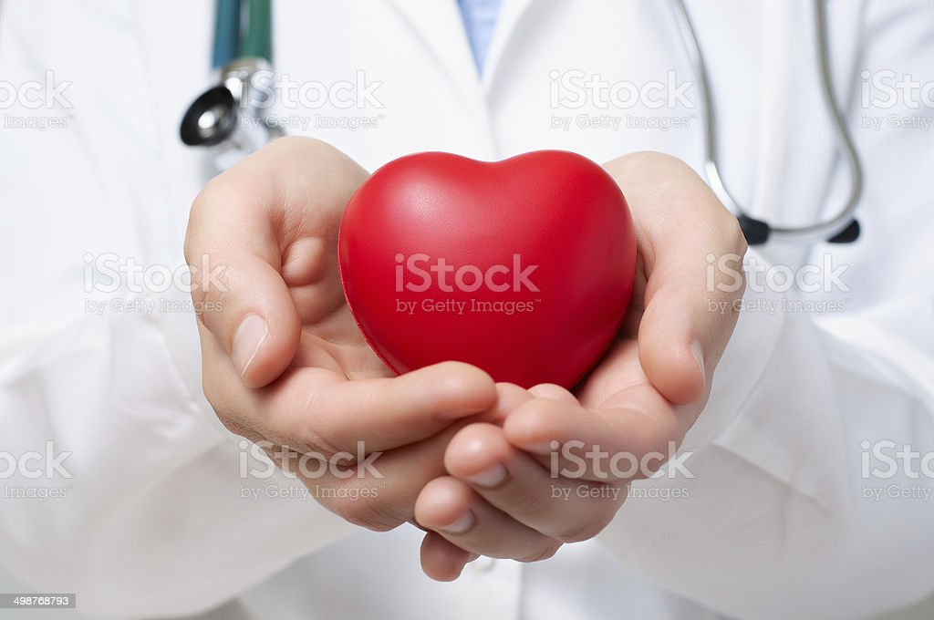 Doctor protecting a heart stock photo