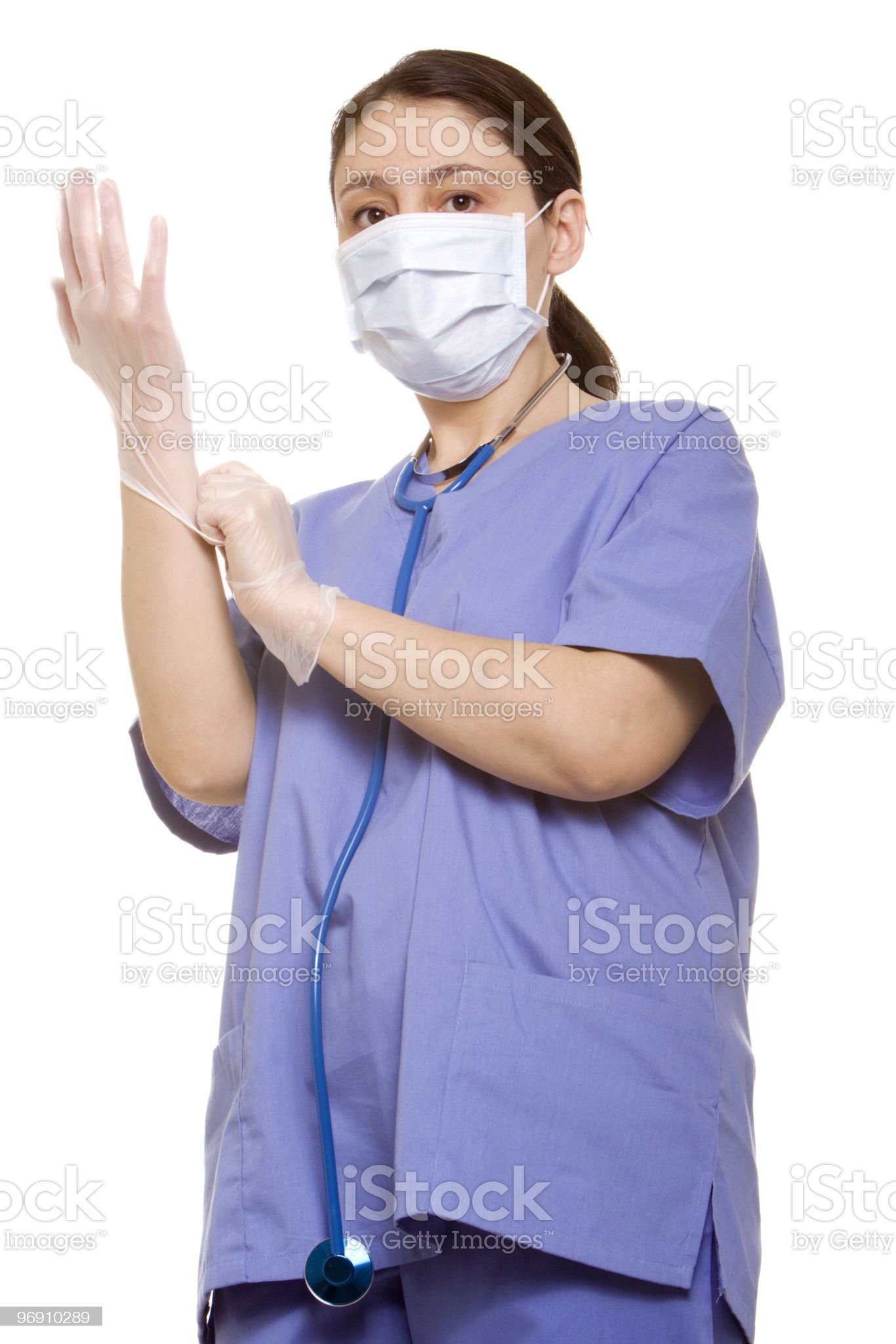 Doctor putting her gloves on royalty-free stock photo