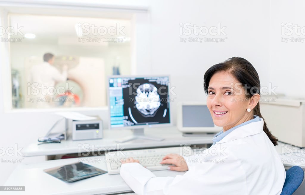 Doctor reading a CAT scan stock photo