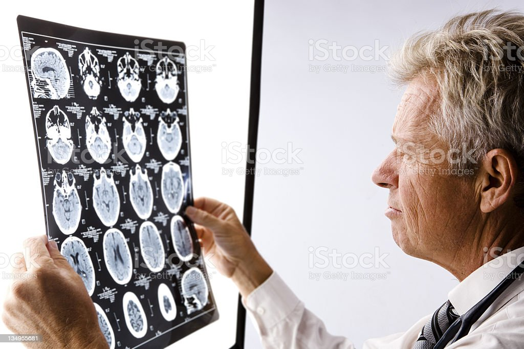 Doctor reading CAT scan stock photo