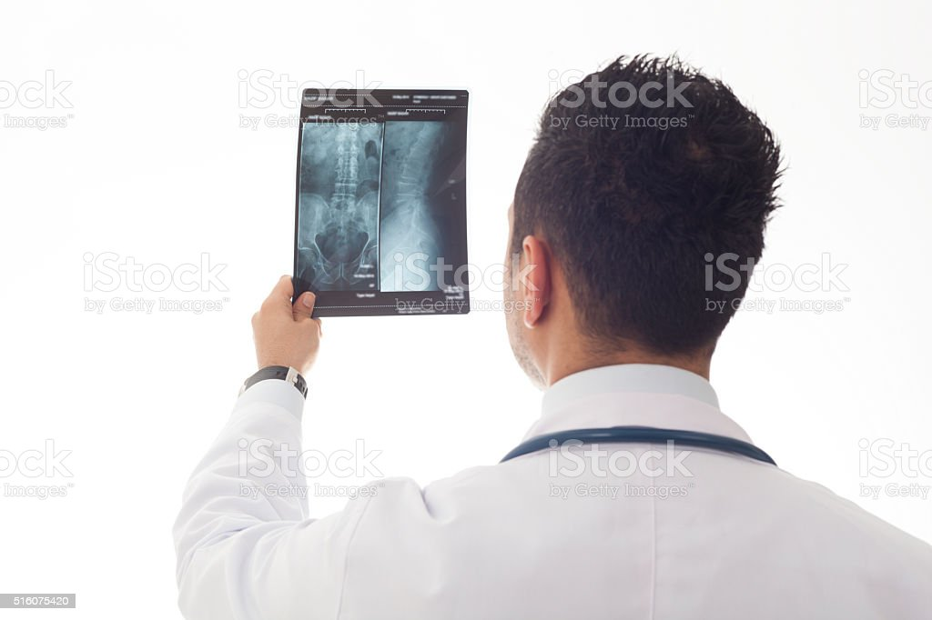 Doctor Reading X-Ray stock photo