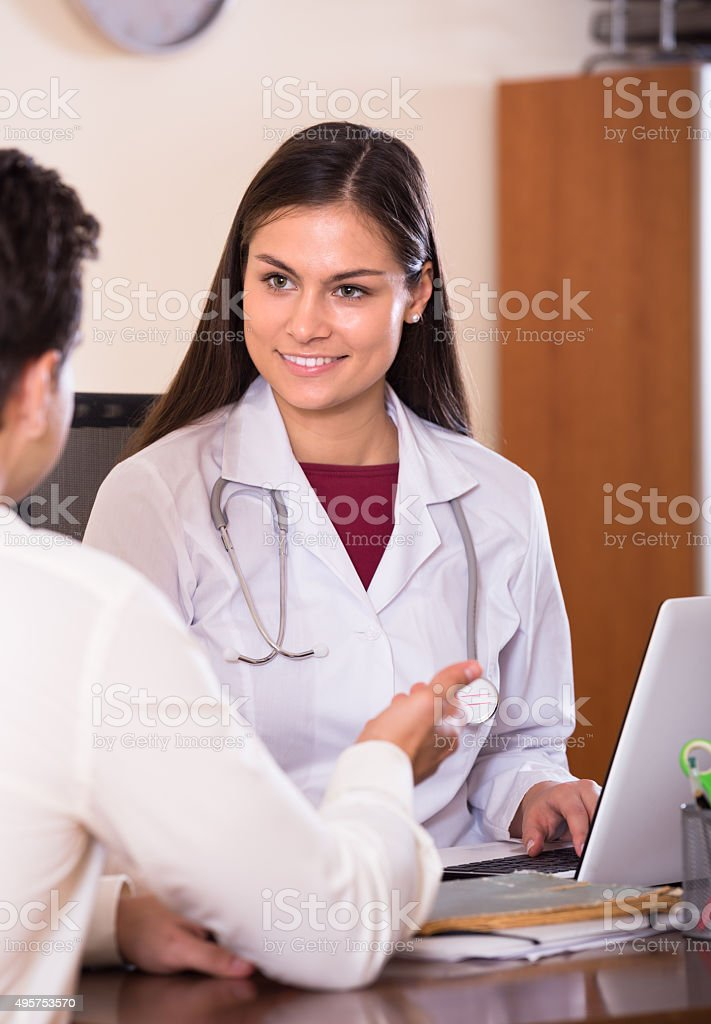 doctor receiving ill patient stock photo