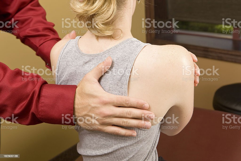 Doctor Rotating Female's Shoulders royalty-free stock photo