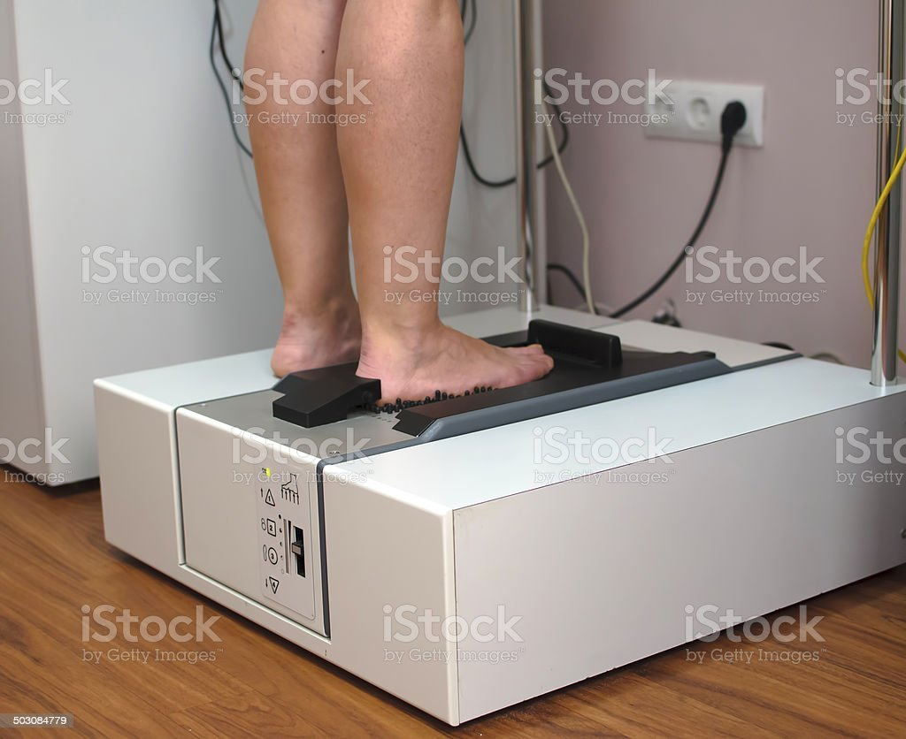 Doctor scanning patient's foot by 3D scanner system royalty-free stock photo