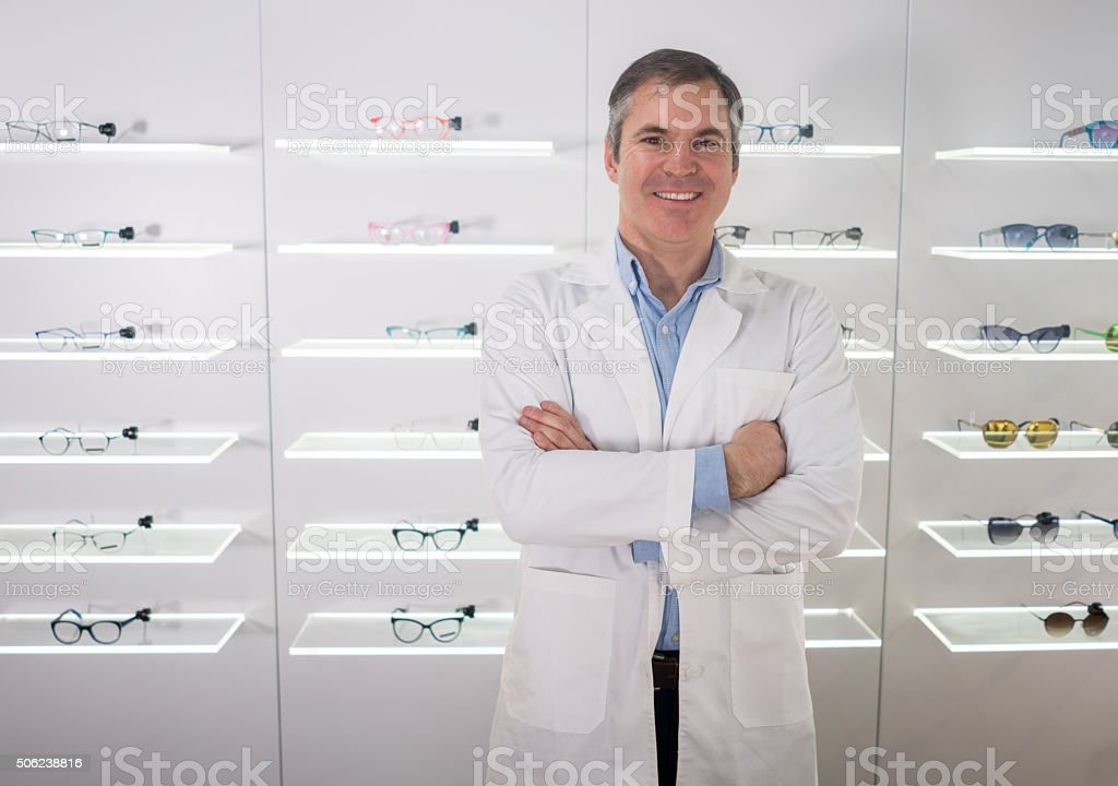 Doctor selling glasses at an optics stock photo