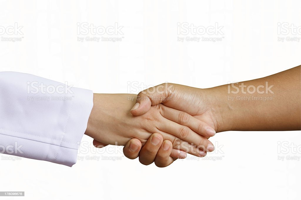 doctor shakes hands with a woman patient royalty-free stock photo