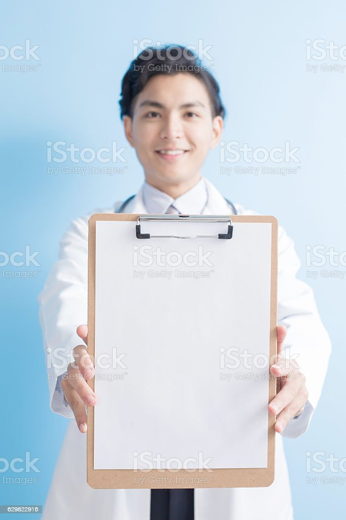 doctor show clipboard to you stock photo