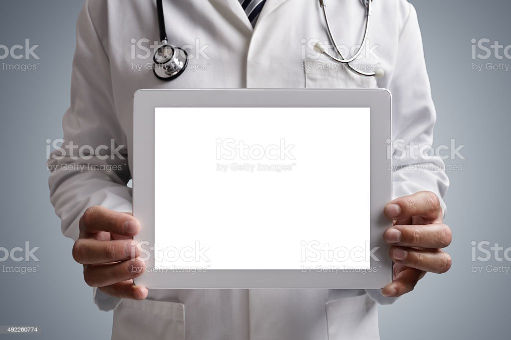 Doctor showing blank digital tablet screen stock photo