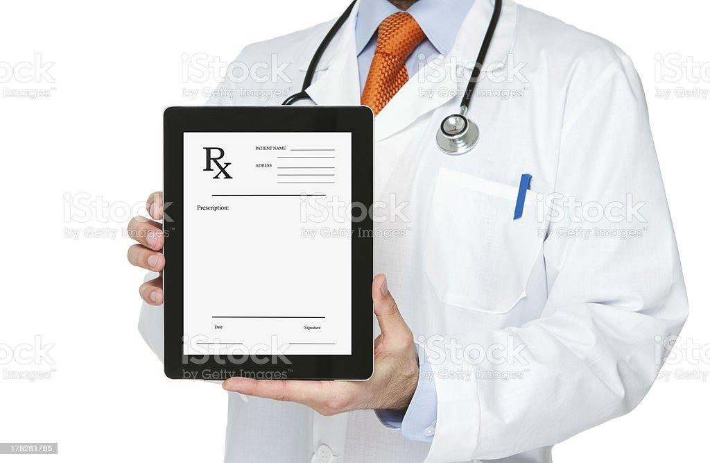 Doctor showing blank prescription at digital tablet stock photo