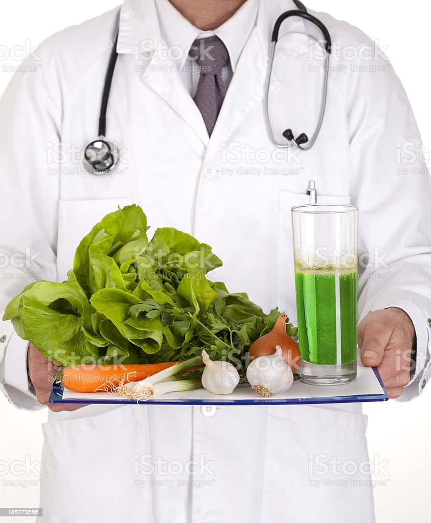 Doctor showing fresh vegetables stock photo