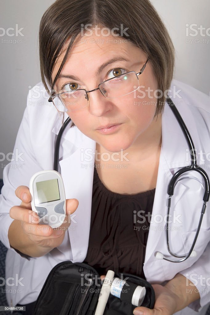 Doctor showing mini digital diabetes measuring meter royalty-free stock photo